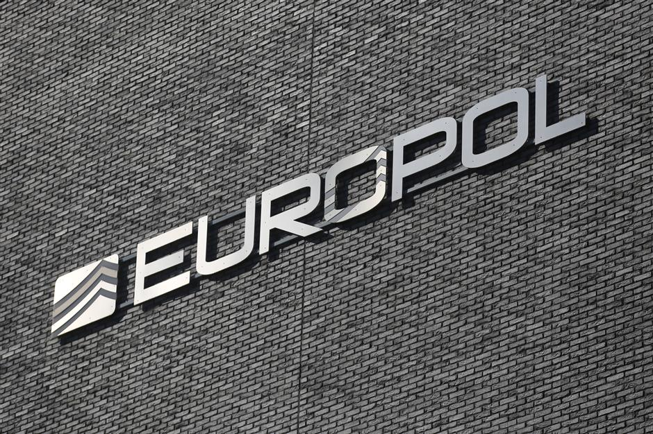 A logo sit on the exterior of the Europol headquarters in The Hague, Netherlands, on Tuesday, March 20, 2018. Europol Executive Directoru00a0Rob Wainwrightu00a0is leaving the EU intelligence agency heu2019s led for almost a decade to help runu00a0Deloitte LLP\'s cybersecurity practice, as companies wake up to the growing u201csystemicu201d threat of cyber crime. Photographer: Yuriko Nakao/Bloomberg