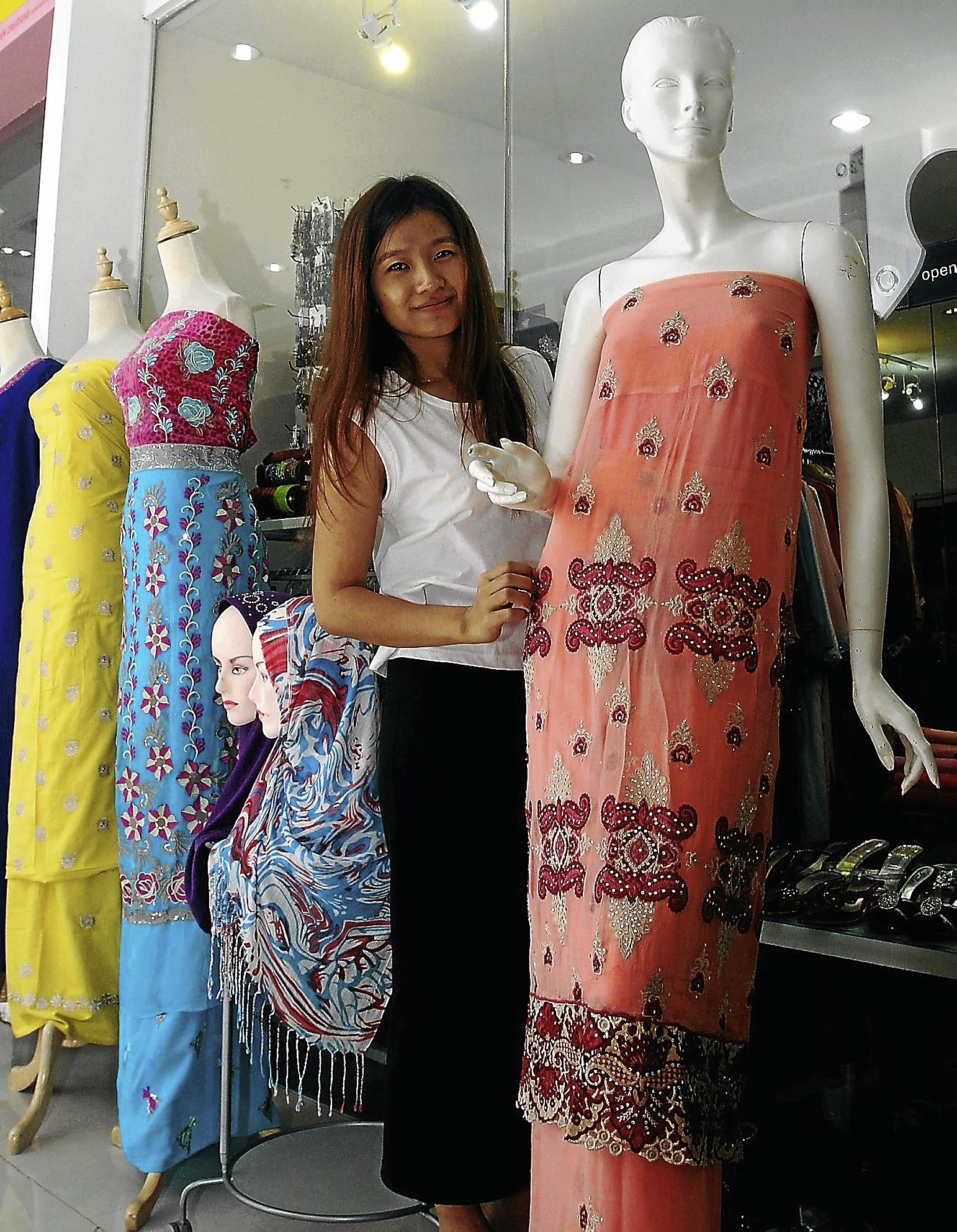 Nin: For this Hari Raya, we¿ve received up to 50 orders in the month of July for Baju Kurung alone.