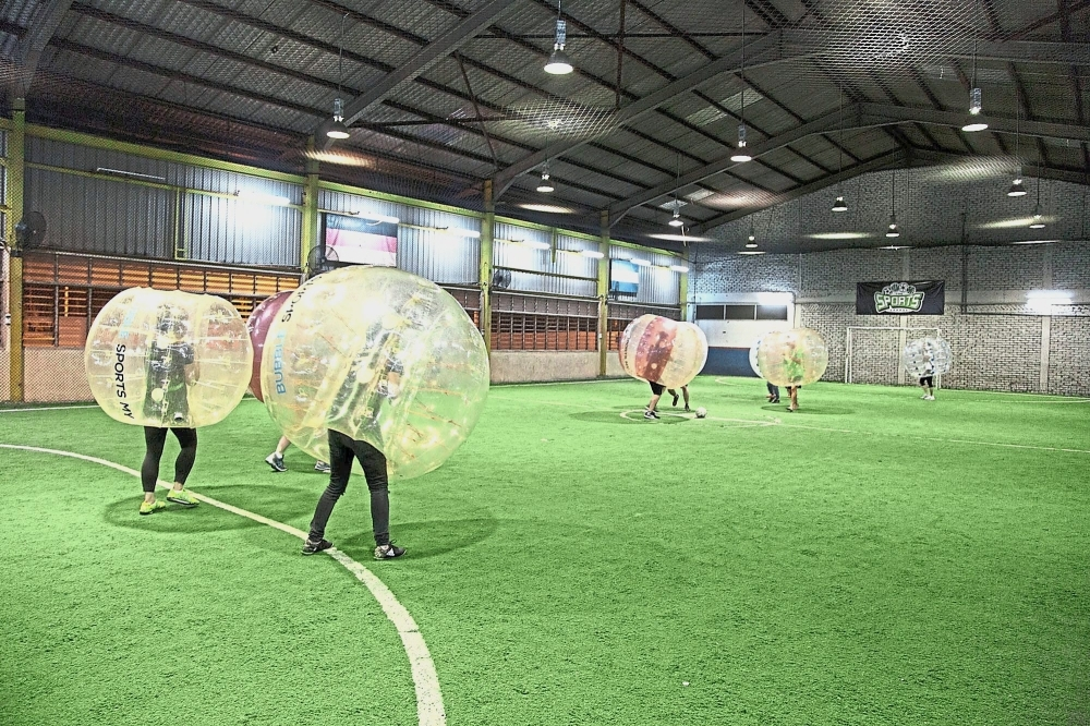 Forefronteers trying out bubble football during one of their monthly activities.