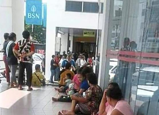 The crowd waiting to collect the RM300 Bantuan Sara Hidup at Bank Simpanan Nasional in Miri.