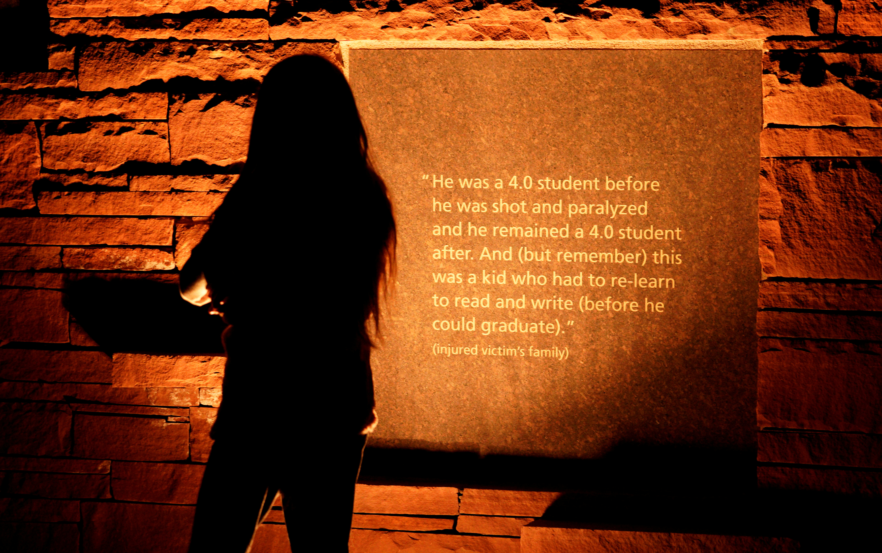 FILE PHOTO: People visit the Columbine memorial after teens kicked off a voter registration rally, a day ahead of the 19th anniversary of the massacre at Columbine High School, in Littleton, Colorado, U.S., April 19, 2018. REUTERS/Rick Wilking/File Photo