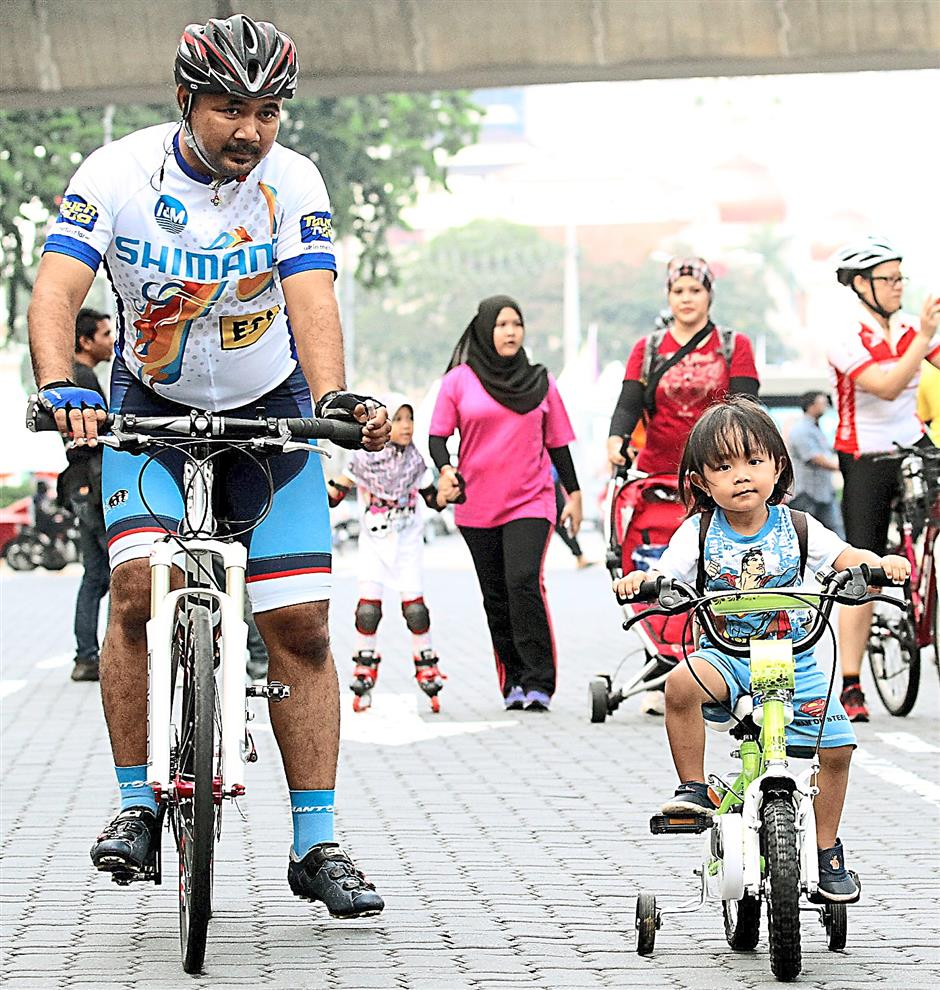 Many parents often bring along their children to Car Free Morning as a healthy family outing.