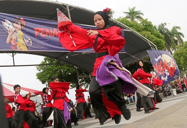 A Malay girl in hijab executing a stunning move during a performance at the Penang Yosakoi 2019.