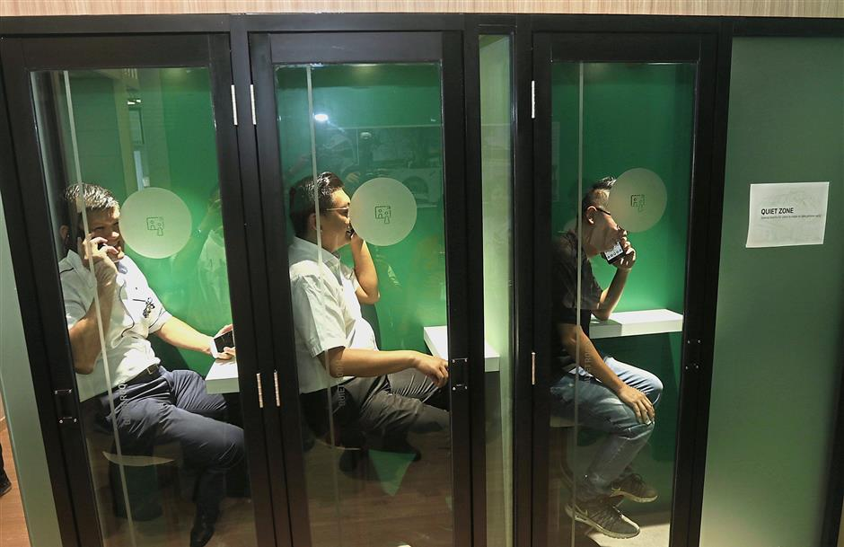 Komtar assemblyman Teh Lai Heng (right) and Batu Lancang assemblyman Ong Ah Teong posing inside the quiet room booths for those who need to answer or make a phone call.