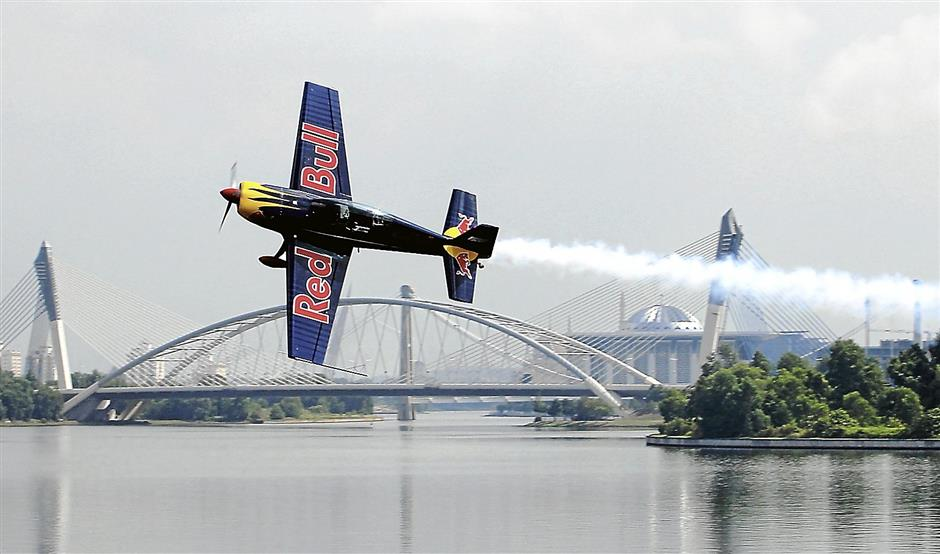 Hungarian acrobatic pilot Peter Besenyei shows his stuff during the launch of the Red Bull Air Race in Putrajaya.