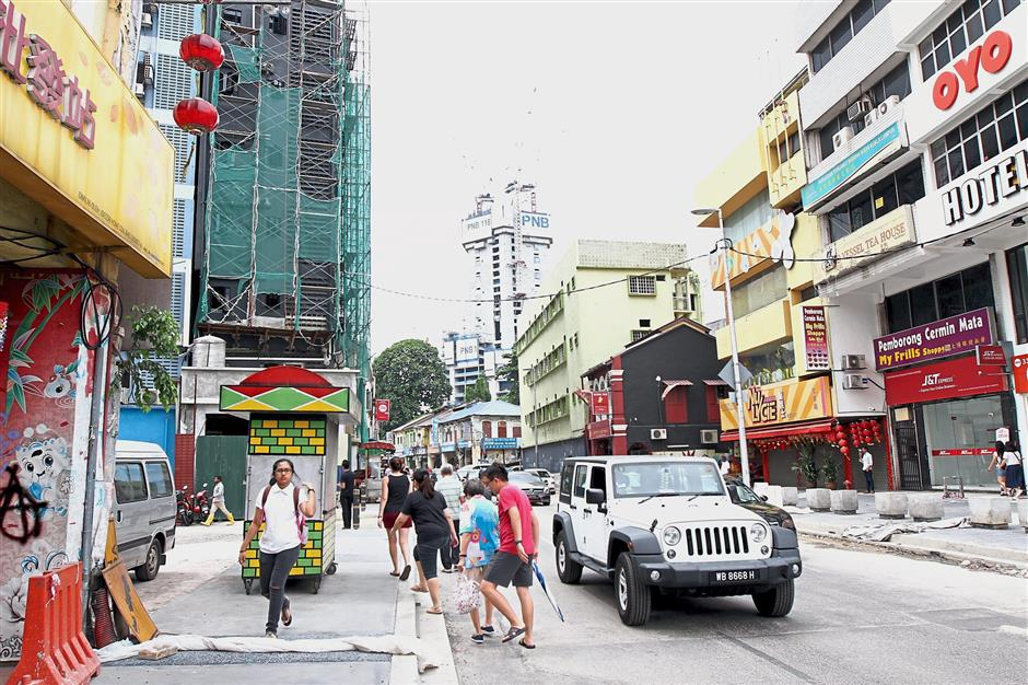 Petaling Street has a rich cultural history with some buildings dating over 100 years.