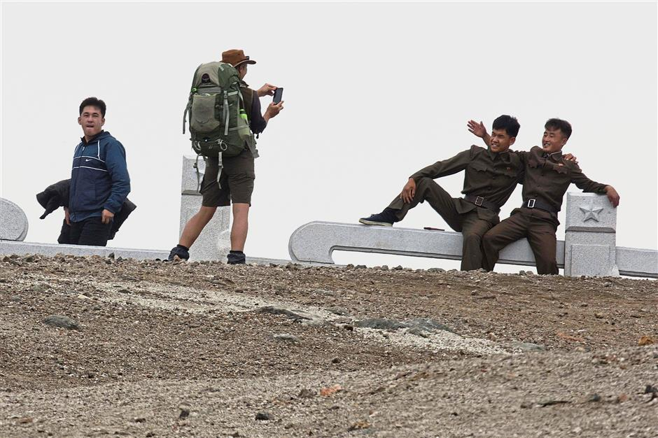 One for the album: An Australian tourist taking a photo of North Koreans during the hike. — AP
