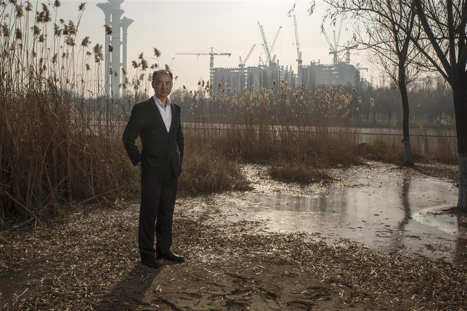 Ma Jun, founder of the Institute of Public & Environmental Affairs, poses for a photograph in a park in Beijing, China, on Saturday, Dec. 2, 2017. Ma\'s years as an environmental activist taught him one lesson: if you want factories to clean up their act, shaming them in front of Apple Inc.u00a0andu00a0Wal-Mart Stores Inc.u00a0works better than government fines. Photographer: Gilles Sabrie/Bloomberg