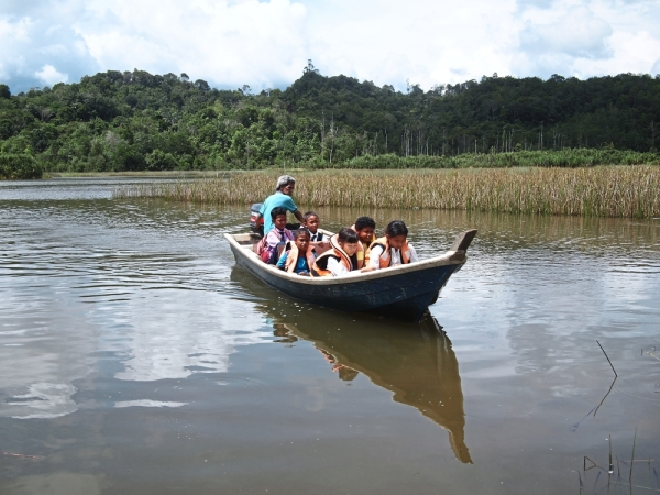 Far from school: Some orang asli children from villages near Tasik Chini, Pahang, have to take a boat to reach their school.