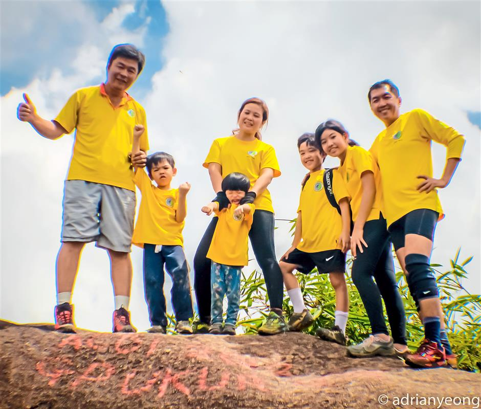 The writer (centre) with her children, husband (right) and Lee Keam Keong of Freewill Hikers at the peak of Gunung Belumut (1010m), Kluang, Johor.