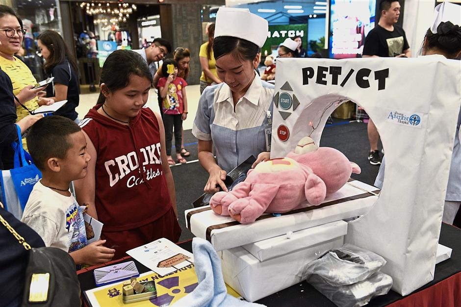 Educational opportunity: Children learning about CT scans and PET scans during the Charity Giant Patchwork Teddy - Mothers Day Celebration at Gurney Plaza.