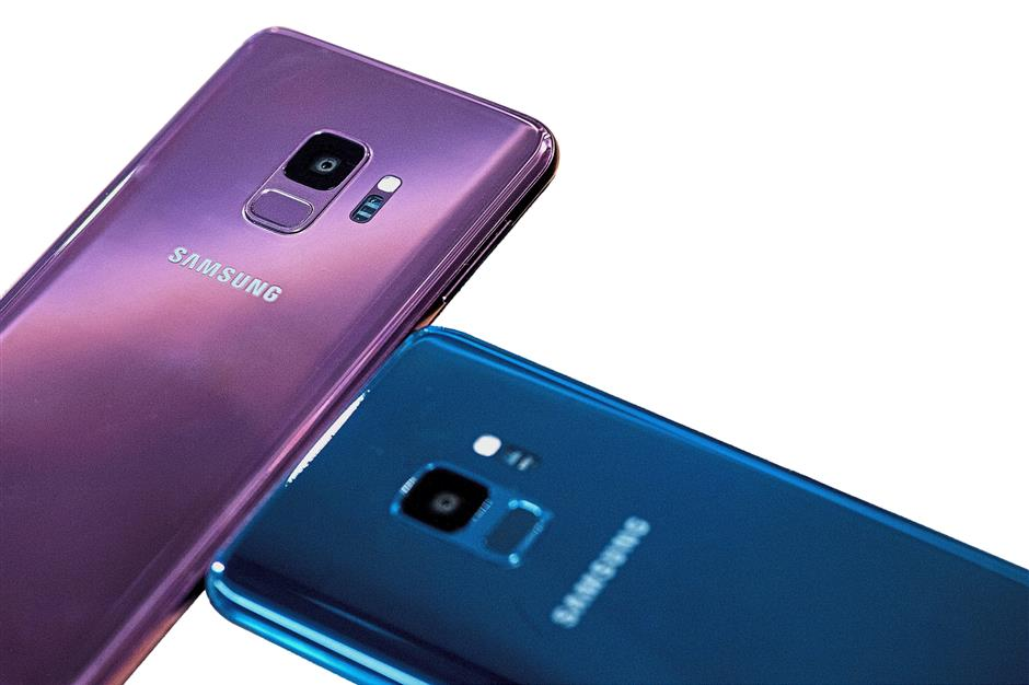 Both smartphones are available in three colours, namely Midnight Black, Coral Blue and the new Lilac Purple except for the spacious Galaxy S9 256GB which comes only in Midnight Black. — Bloomberg