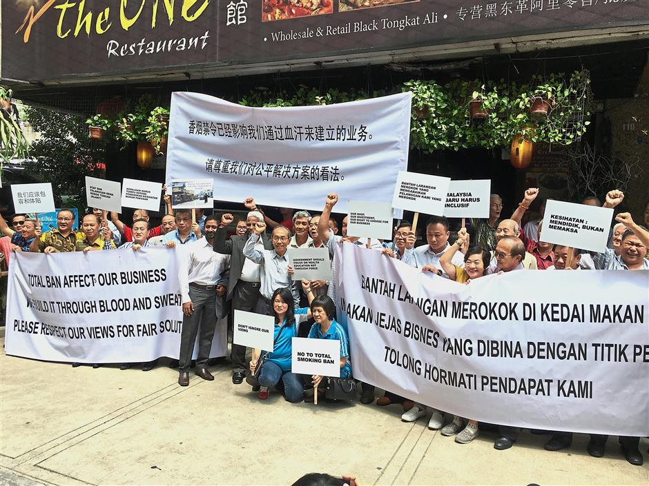 Ban on the run: Coffeeshop and restaurant owners gathering to object against the smoking ban in Kuala Lumpur.