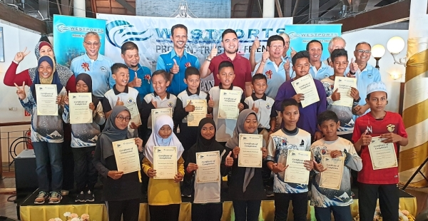 Tengku Amir (back row, fifth from left) with students from Pulau Indah and representatives of the RSYC and Westports Malaysia at the launch of the 2019 RSYC-Westports Community Youth Sailing Programme.