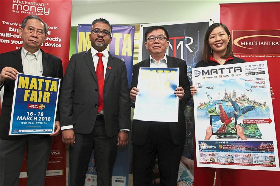 (From left) Lim, Merchantrade Asia Sdn Bhd chief money services business officer Sarveswaran Raja Gopal, Phua and Au at the press conference held at Wisma MATTA in Fraser Business Park, Kuala Lumpur.