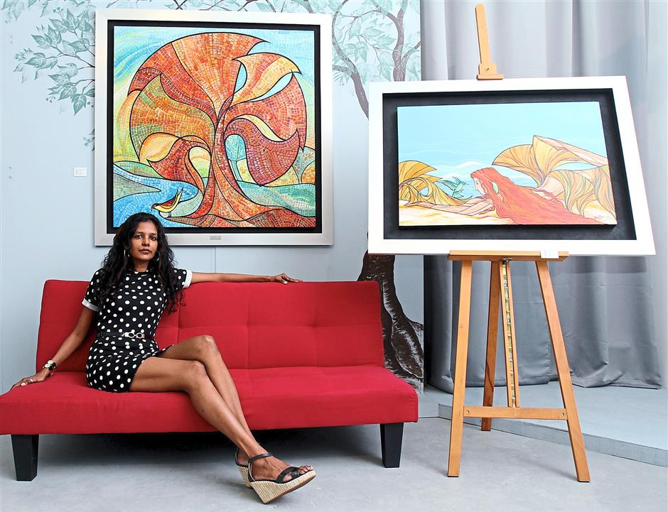 Animal lover: Das and her acrylic paintings titled Nature in Check (left) and Attraction.