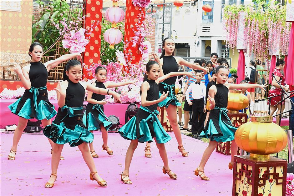 Girls performing a modern dance at the Penang Chinese New Year Celebration 2019 in Armenian Street, George Town. — Photos: MUSTAFA AHMAD and CHAN BOON KAI/The Star