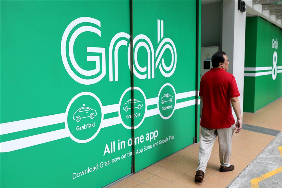 Grab to double Singapore staff to 3,000 in latest expansion | The