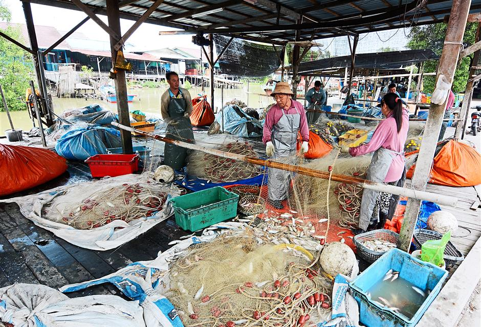 The fishermen sells their daily catches to Chias business to be distributed and sold in markets at bigger cities.
