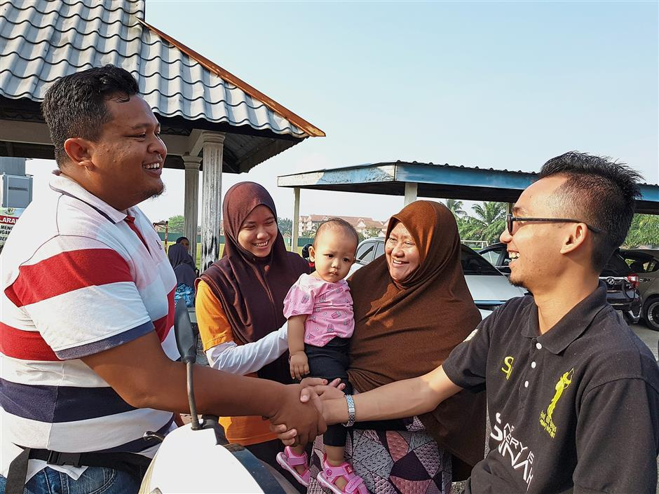 Polling stations became a place for old friends and neighbours to meet as seen here in SK Bandar, in Kuala Langat.