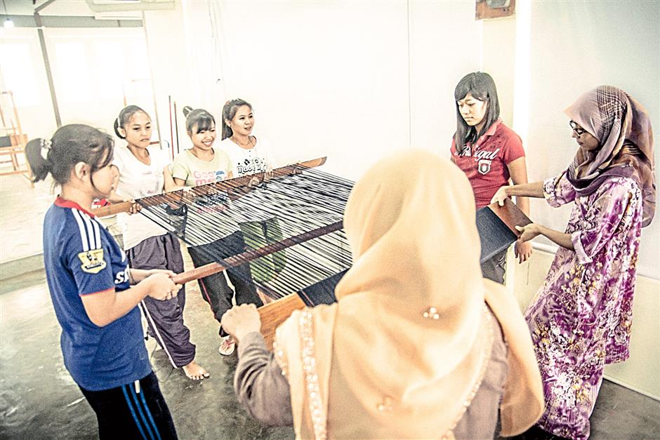 Through a mentorship programme, trainees are supervised by highly-skilled senior weavers.