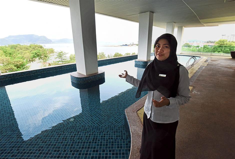 Adya Hotel employee Nurul Izaty Noordin showing the private swimming pool for female guests at the hotel in Langkawi.