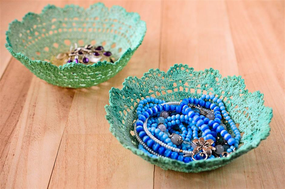 Store tiny trinkets in vintage lace bowls made out of old doilies.