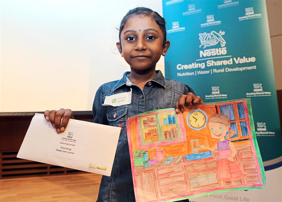 1 Hasmukhpinder explaining the gap between supply and demand for water globally at the StarLIVE session – Nestle's Water Guide: Save Every Drop at Menara Star in Petaling Jaya.2 Thivyasri Ganesh, 6, who won the colouring contest held in conjunction with the StarLIVE session.3 The works of the top three winners in the colouring contest.— Kamarul Ariffin / The Star