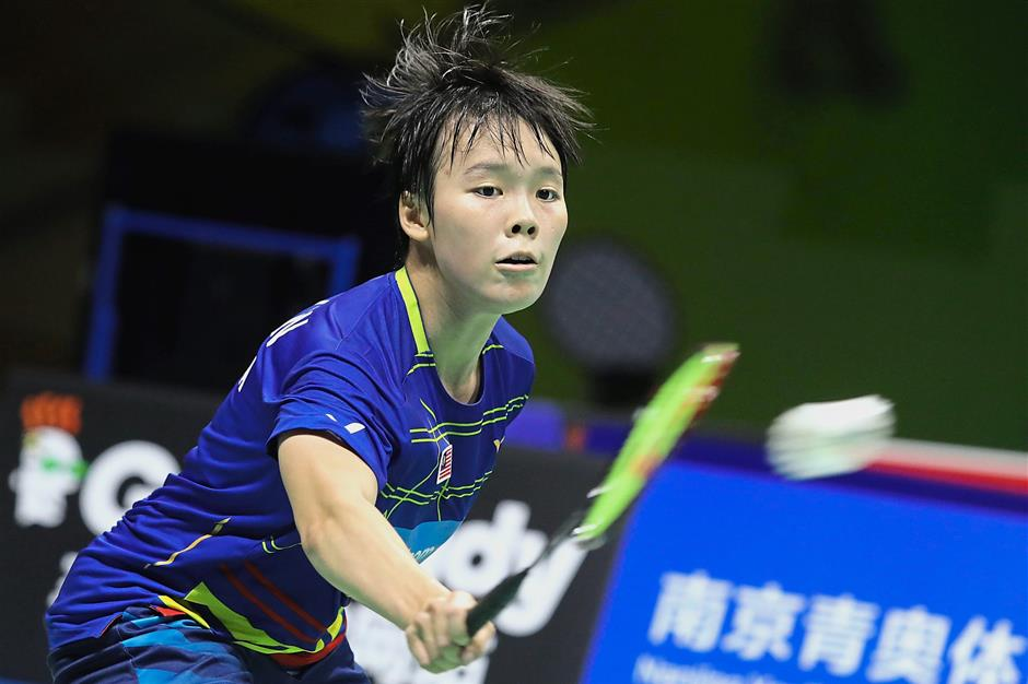 Malaysian Goh Jin Wei in action against Pai Yu Po of Chinese Taipei during the first round of BWF World Championships at Nanjing Youth Olympic Games Sports Park Arena on Monday. IZZRAFIQ ALIAS / The Star. July 30, 2018.