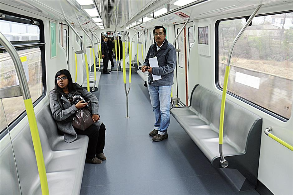 Malaysian journalists trying out the seats in the new coaches.