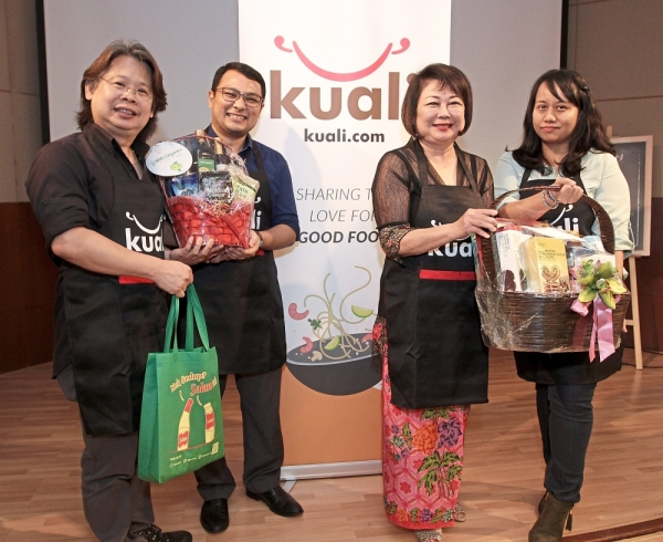 (From left) Lau, Sandip, Iris and Syazwin with some of the prizes they won for their recipes.