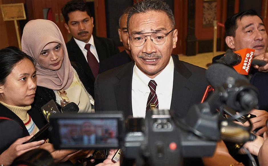 On foreign policy: Hishammuddin speaking to reporters at Parliament.