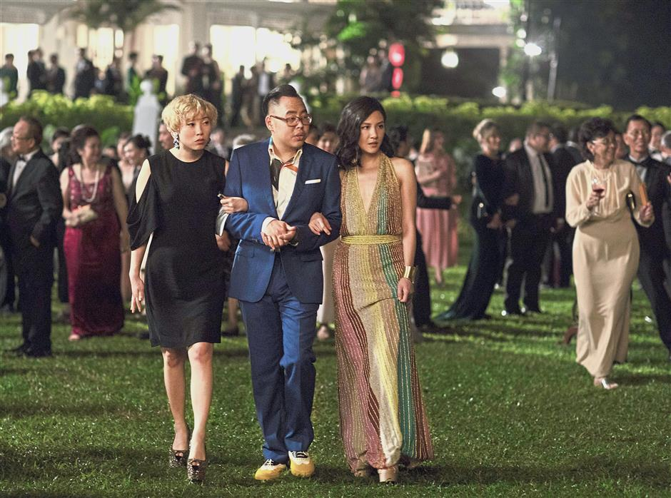 Inequality bites: In Singapore, households with accumulated wealth and connections over past generations, like the hit movie's protagonist Nick Young's family and friends, can pass on advantages to their offspring. — AP