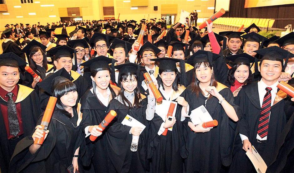 We did it: Swinburne University graduates scream with joy as they celebrate their graduation day.