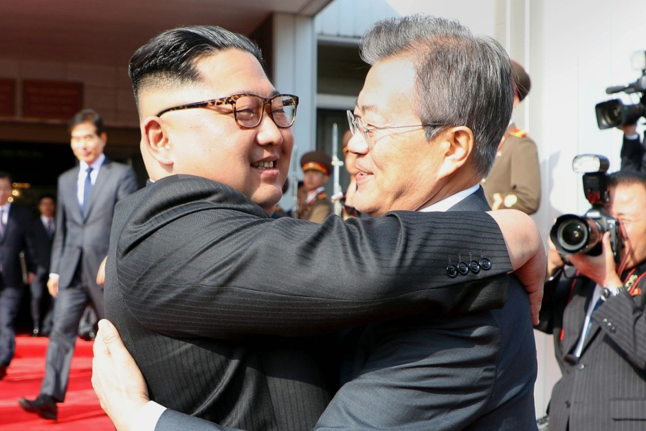 South Korean president Moon Jae-in (right) hugging North Korea\'s leader Kim Jong-un a surprise second summit at the north side of the truce village of Panmunjom in the Demilitarized Zone (DMZ) on May 26, 2018. u2013 AFP