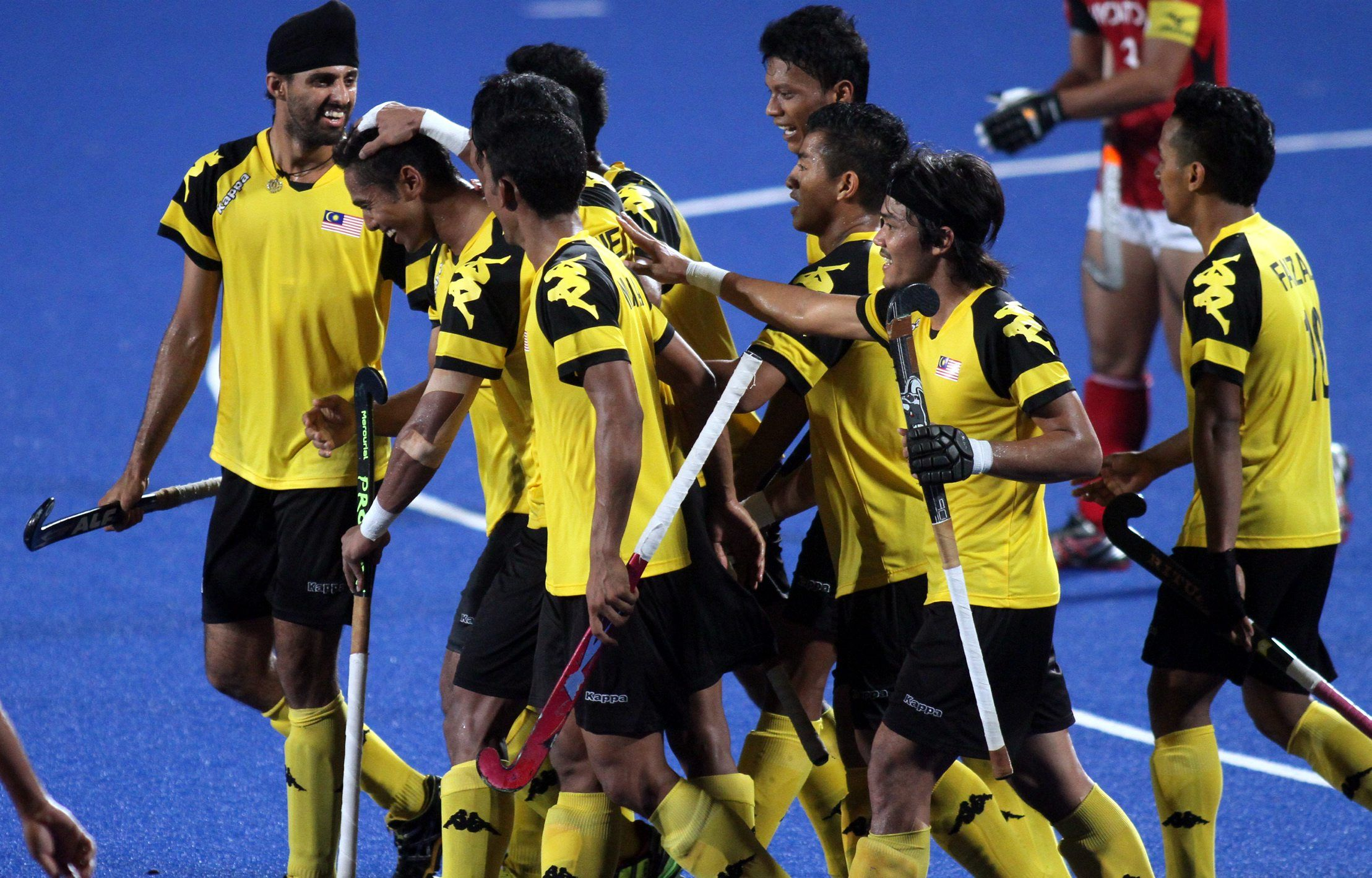 Members of the senior hockey team at the Asia Cup last year. The training programme for the national team will be reviewed, after the Government decided to cut 30% of the Malaysian Hockey Confederation\'s funding.