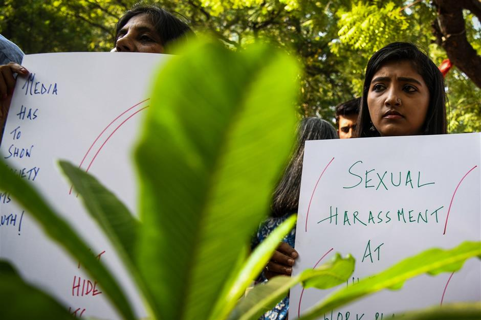 Indian journalists hold placards at a protest against sexual harassment in the media industry in New Delhi on October 13, 2018. - India\'s #MeToo movement has engulfed Bollywood figures, a government minister and several comedians and top journalists. (Photo by CHANDAN KHANNA / AFP)