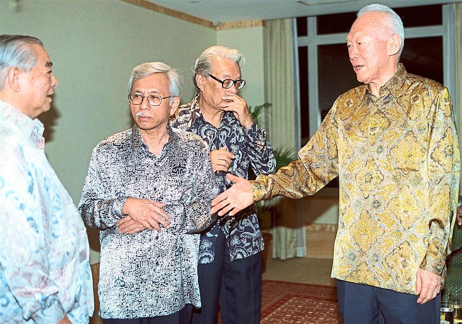 Old pals: Lee (right) ?having a light moment with his old friends (from left) former Penang chief minister Lim Chong Eu, former finance minister Tun Daim Zainuddin and former health minister Tan Sri Chong Hon Nyan in this 2000 file pic.