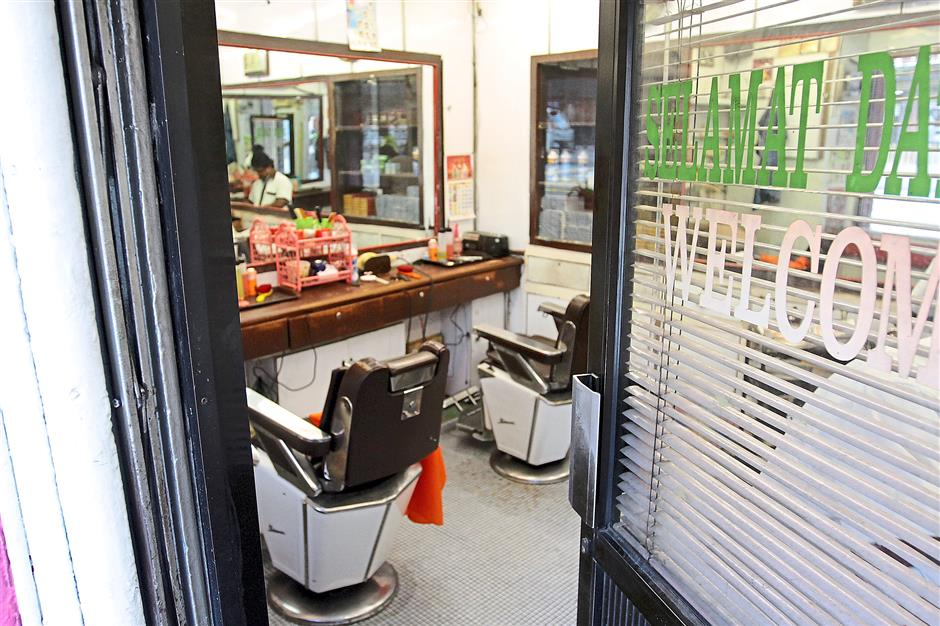 Colonial charm: Stylo Indian barbershop has been on the street for 75 years.