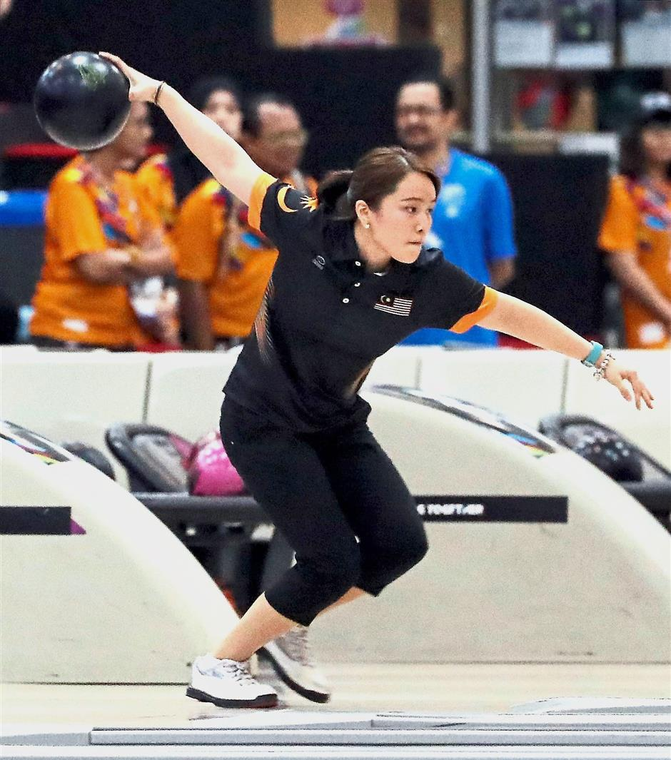 Not meant to be: Sin Li Jane lost 2-0 to Jung Da-wun in the womenu2019s Masters final at the South Point Bowling Centre in Las Vegas on Monday.