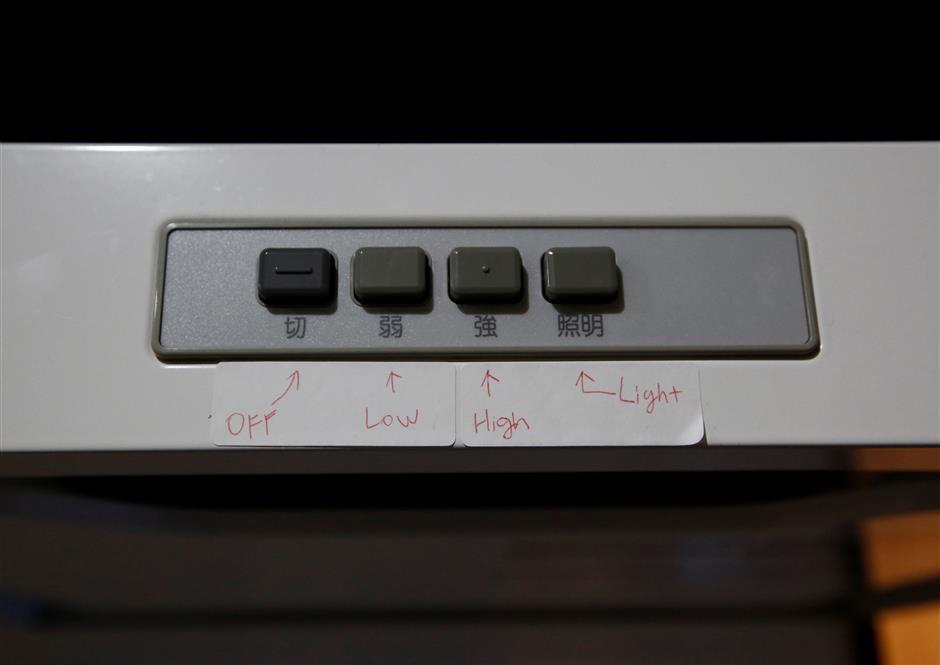 English translations are attached on switches of a fan at an an apartment which is used as Airbnb service in Tokyo, Japan March 12, 2018. Picture taken March 12, 2018.  REUTERS/Kim Kyung-Hoon