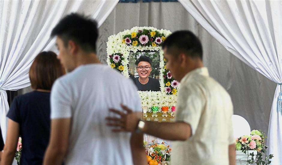Solemn moment: Friends and family members paying their last respects to Moey during the wake in Butterworth.