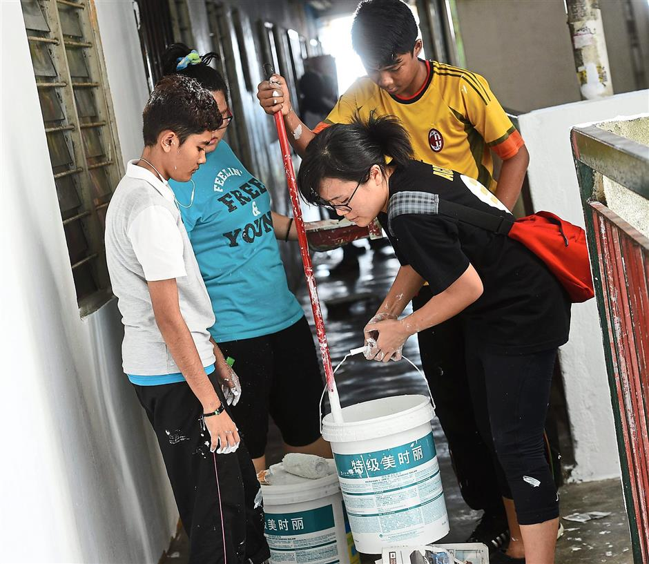 Leong (in black) helping out the volunteers who were from Agape Vision and also residents of the sixth floor