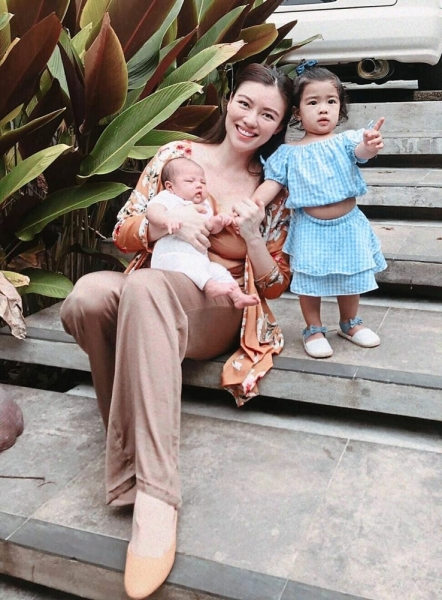 Caring mum: Ng with her children at home. She says there's nothing like seeing their milestones.