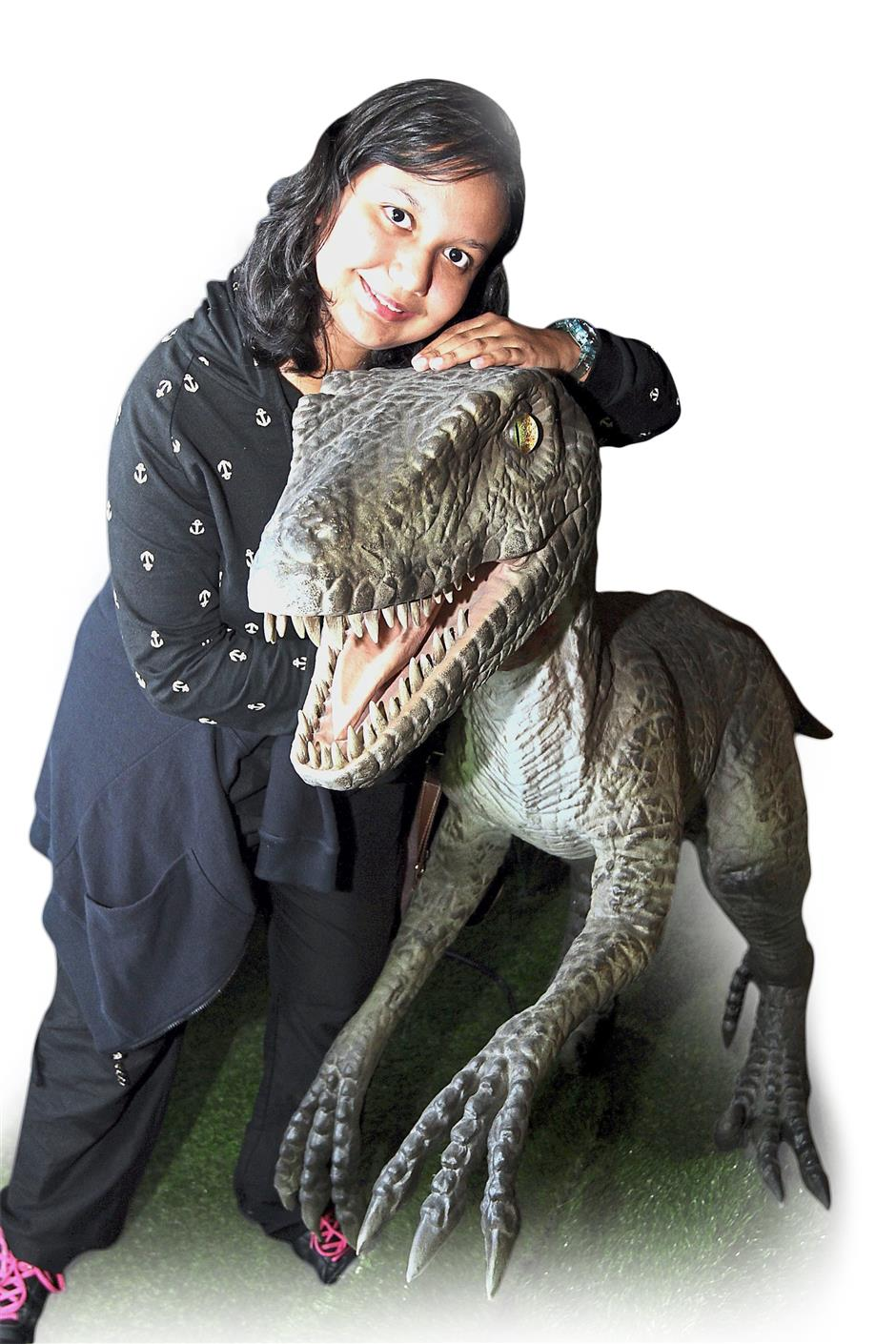 Jasvina is brave indeed as she hugs a life-size dinosaur model at the Jurassic Research Centre.