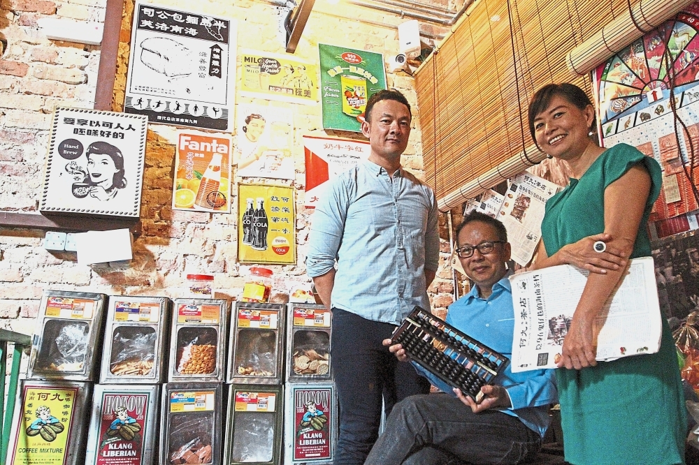 (From left) Low, Mah and Lee Leng said they are trying to bring back Petaling Street's former glory and preserve its business brands.