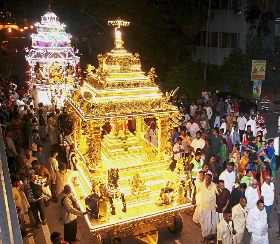The Sri Maha Mariamman Temple golden and silver chariots being pulled by devotees all the way to Batu Caves. This is the first time the golden chariot is being used for the procession. Previously, there was only the silver chariot.