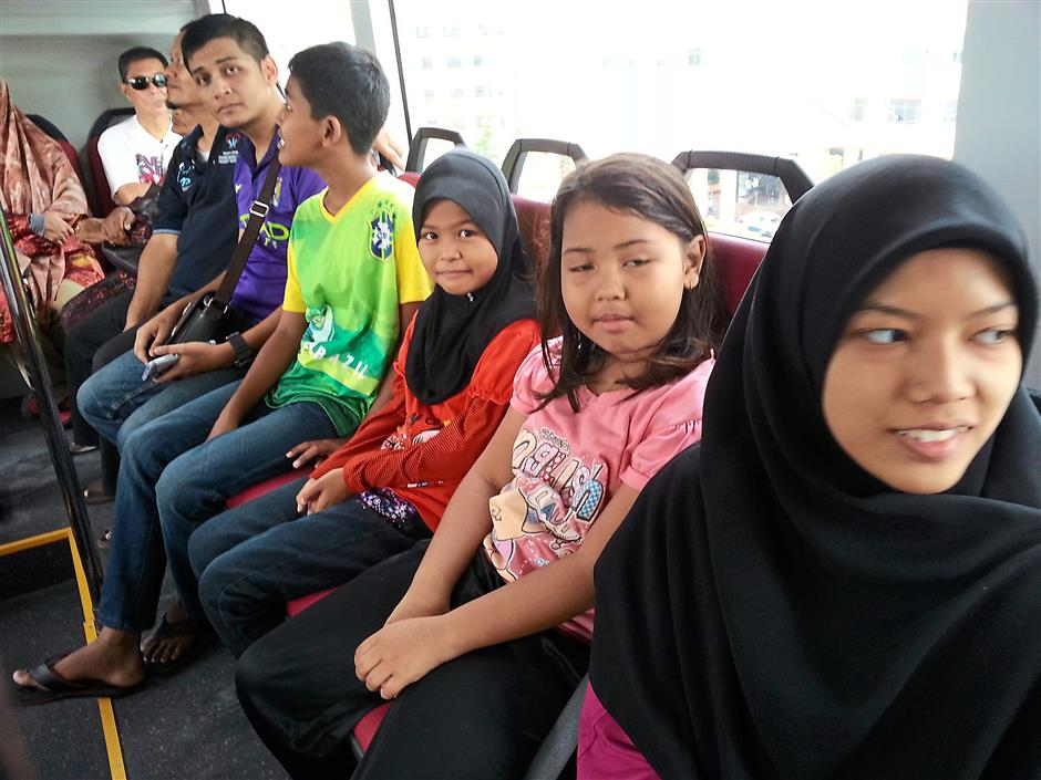 Siti Sarah Azalan, 19 (right) from USJ 6 said she and her family were keen to explore Sunway with the help of the bus.
