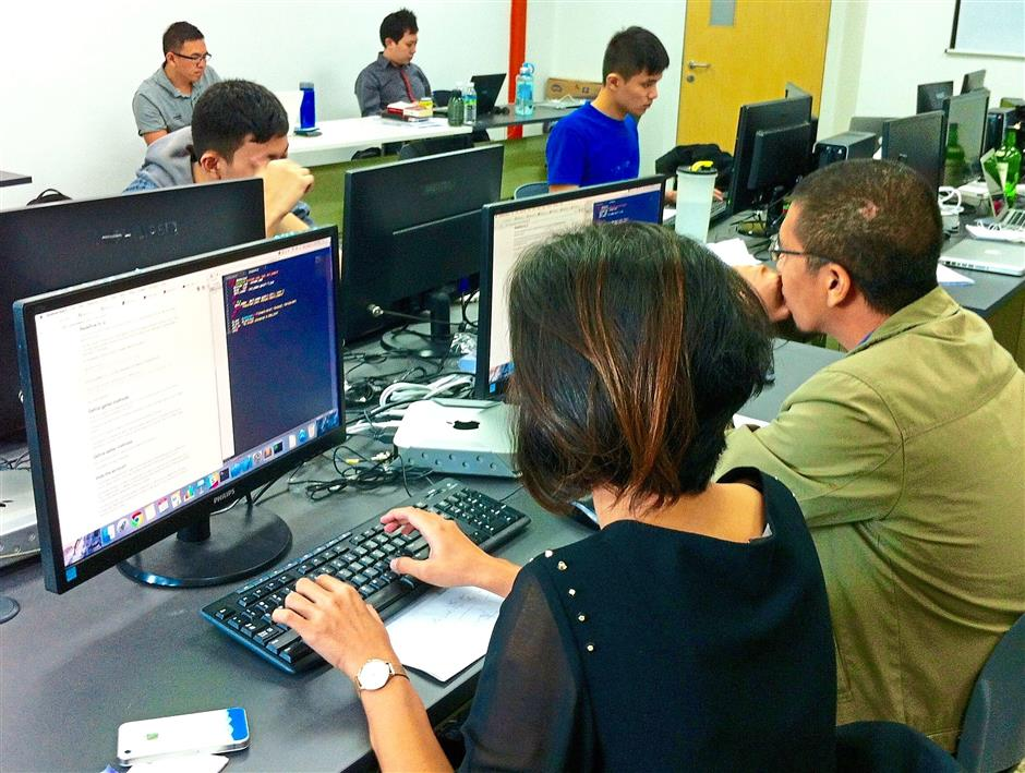 Hot skill: Students learn to build web applications within nine weeks at NEXT Academy.