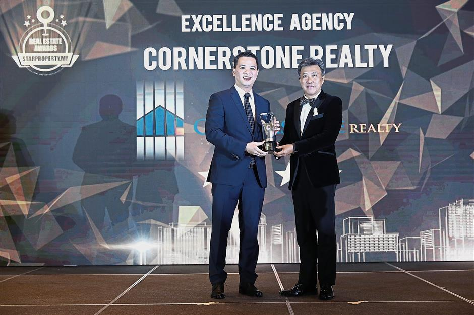 Class act: Yau Long (left) receiving the Excellence Agency (Four Stars) Award from Star Media Group Bhd CEO and MD Datuk Seri Wong Chun Wai at the Star Property Real Estate Awards 2018 gala night.